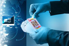 Businessman showing playing cards Stock Photography