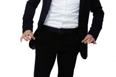 Businessman showing pockets Stock Photography