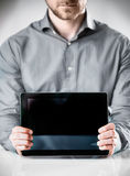 Businessman Showing Powered Off Tablet Computer Royalty Free Stock Photo