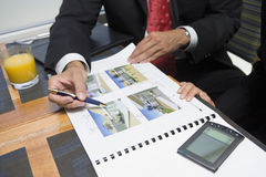 Businessman Showing Property Samples To His Business Partner Stock Images