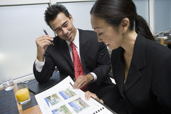 Businessman Showing Property Samples To His Business Partner Royalty Free Stock Photo