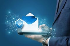 Businessman showing protected email . Businessman showing protected email on the tablet Royalty Free Stock Photos
