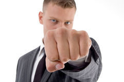 Businessman showing punch Stock Images