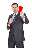 Businessman showing red card Royalty Free Stock Images