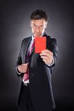 Businessman showing red card Royalty Free Stock Photography