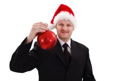 Businessman showing red Christmas ornament Stock Photo