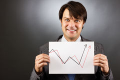 Businessman showing a rising graph, representing business growth Stock Image