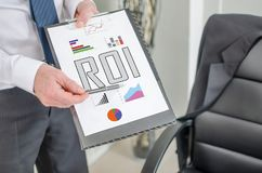 Roi concept on a clipboard. Businessman showing roi concept on a clipboard stock illustration