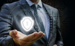 Businessman showing a shield protection . The concept of protecting a computer network Royalty Free Stock Photo