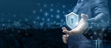 Businessman showing a shield of protection network. royalty free stock images