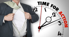 Businessman showing shirt against clock. Businessman showing superhero suit underneath his shirt standing against clock with time for action - path for the shirt royalty free stock photo