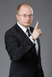 Businessman showing sign of attention Stock Photography
