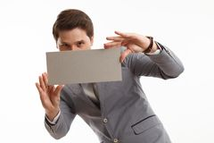 Businessman showing signboard with copyspase, on white Royalty Free Stock Images