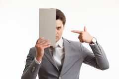 Businessman showing signboard with copyspase, on white Royalty Free Stock Photography