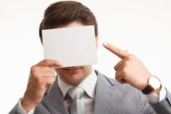 Businessman showing signboard with copyspase, on white Stock Photos
