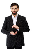 Businessman showing the size with hands. Royalty Free Stock Photos