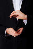 Businessman showing the size with hands. Stock Photography