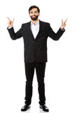 Businessman showing the size with two fingers. Stock Photos