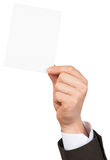 Businessman showing small blank card Royalty Free Stock Images