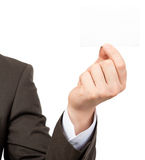 Businessman showing small blank card Stock Image