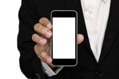 Businessman showing smart phone, with copy space Royalty Free Stock Photo