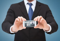 Businessman showing smartphone with blank screen Stock Images