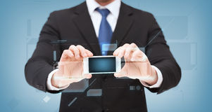 Businessman showing smartphone with blank screen Royalty Free Stock Photos