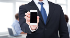 Businessman showing smartphone with blank screen Royalty Free Stock Image