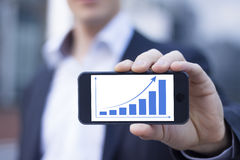 Businessman showing smartphone Royalty Free Stock Photo