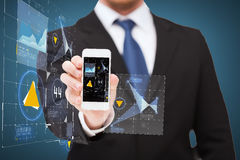 Businessman showing smartphone with virtual screen Royalty Free Stock Photos