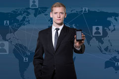Businessman showing smartphone Royalty Free Stock Image