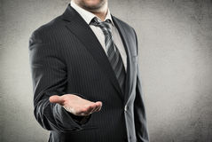 Businessman showing smth Stock Photography