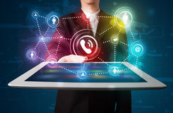Businessman showing social networking technology with colorful l Stock Photography