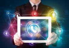 Businessman showing social networking technology with colorful l Royalty Free Stock Image