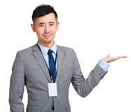 Businessman showing something by hand Stock Photos