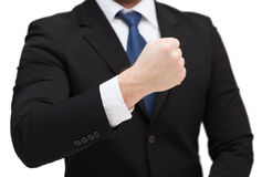 Businessman showing something at his hand. Time, business and new technology concept - close up of businessman showing something at his hand Royalty Free Stock Image