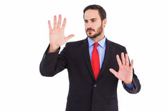 Businessman showing something with his hands Stock Images