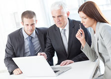 Businessman Showing Something to His Colleagues Royalty Free Stock Images
