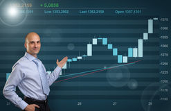 Businessman showing Stock market graph Stock Photo