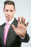 Businessman showing STOP Royalty Free Stock Photography