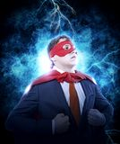 Businessman showing the super man suit under his shirt stock photography