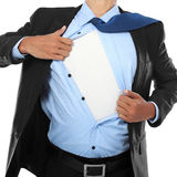 Businessman showing a superhero suit. Underneath his suit royalty free stock photos
