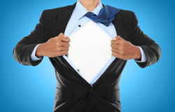 Businessman showing a superhero suit Stock Photo