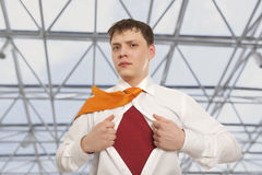 Businessman showing the superhero suit Royalty Free Stock Photo