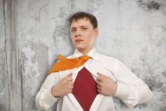 Businessman showing the superhero suit Stock Photography