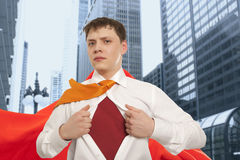 Businessman showing the superhero suit Stock Photos