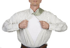 Businessman showing a superhero suit underneath his shirt Stock Photography