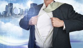 Businessman showing superhero suit underneath his shirt Stock Image