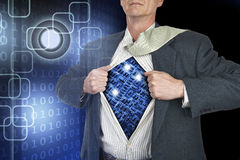 Businessman showing superhero suit underneath his shirt standing Royalty Free Stock Images