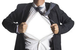 Businessman showing a superhero suit underneath his suit Royalty Free Stock Photography